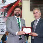 Mr. Ibrahim Sanai, Minister Education & Information presenting souvenir to Dr. Shahid Rashid