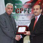 Prof. Dr. Khalil Ahmed, Vice Chancellor KIU presenting souvenir to Brig. Siddique