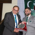 Dr. Shahid Rashid, Executive Director CoE-CPEC presenting souvenir to Hassan Dawood Butt