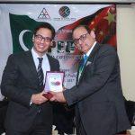 Mr. Hassan Dawood Butt presenting souvenir to Mr. Mustafa Haider Syed