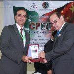 Mr. Hassan Dawood Butt presenting souvenir to Mr. Ali Raza Hanjara