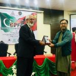 Minister for Planning, Development and Information, Iqbal Hassan presenting souvenir to Dr. Amir Khan Head of Policy Division Socio-Economic Impacts of CPEC